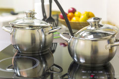Ceramic hob with pans stock photography