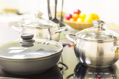 Ceramic hob with pans Royalty Free Stock Photo