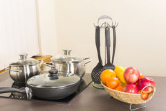 Ceramic hob with pans Royalty Free Stock Images