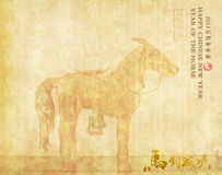 Ceramic horse souvenir on old paper. Chinese calligraphy. word for horse, 2014 is year of the horse Stock Photo