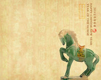 Ceramic horse souvenir on old paper Royalty Free Stock Photo