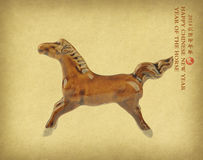 Ceramic horse souvenir on old paper Stock Photo