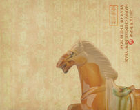 Ceramic horse souvenir on old paper Royalty Free Stock Photography