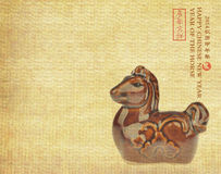 Ceramic horse souvenir on old paper Royalty Free Stock Image