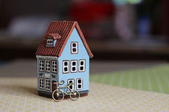 Ceramic house. Little blue ceramic house and bicycle Stock Photos