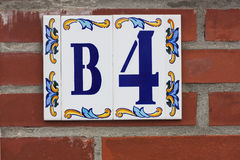 Ceramic house number B4 Stock Photography