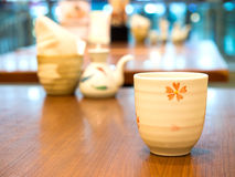 Ceramic Japanese tea cup on wood table Royalty Free Stock Images