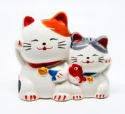 Ceramic Japanese welcoming Cats or lucky Cat ( Maneki Neko ). Ceramic Japanese welcoming Cats or lucky Cat ( Maneki Neko royalty free stock photos