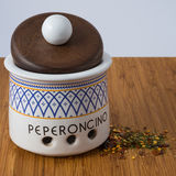 Ceramic Jar. Ceramic chilly jar the word peperoncino mean chilly peppers Royalty Free Stock Images