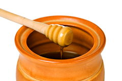 Ceramic jar with honey and wooden stick Stock Photos
