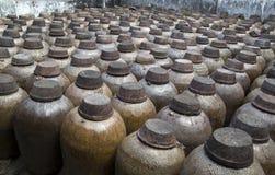 Ceramic jars in distillery stock image