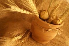 Ceramic jug. Armenian ceramic jug with dried roses Stock Images