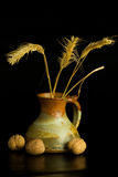 Ceramic jug. The old fashion ceramic jug with nuts Royalty Free Stock Images
