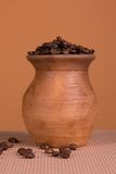 Ceramic jug with coffee beans Royalty Free Stock Photography