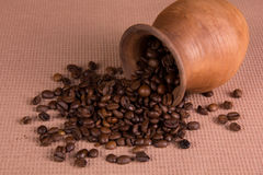 Ceramic jug with coffee beans Royalty Free Stock Image