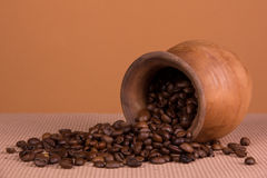 Ceramic jug with coffee beans Stock Photography
