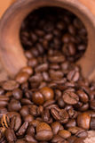 Ceramic jug with coffee beans Stock Photo