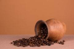 Ceramic jug with coffee beans Stock Images