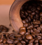 Ceramic jug with coffee beans Stock Photos