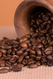 Ceramic jug with coffee beans Royalty Free Stock Images