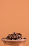 Ceramic jug with coffee beans Royalty Free Stock Photo