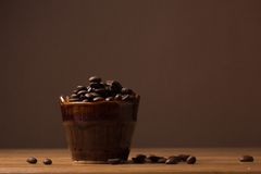 Ceramic jug with coffee beans Royalty Free Stock Photos