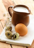 Ceramic jug with milk and eggs  , Stock Photography