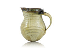 Ceramic jug. Small ceramic jug isolated on white background with slight reflection Royalty Free Stock Photography