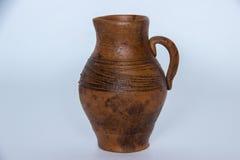 Ceramic jug. Stylish ceramic jug on a gray background Royalty Free Stock Images