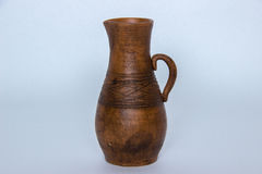 Ceramic jug. Stylish ceramic jug on a gray background Royalty Free Stock Image