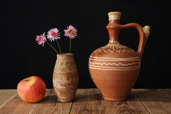 Ceramic jug and three flower Royalty Free Stock Image