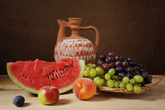 Ceramic jug and watermelon Royalty Free Stock Photography