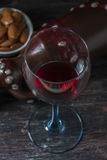Ceramic jug for wine , cheese, nuts on a wooden board, background. Royalty Free Stock Images