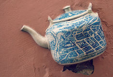 Ceramic Kettle on Wall of Vilnius, Lithuania Stock Image