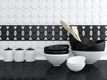 Ceramic kitchenware. Kitchen utensils on the marble worktop. White and black ceramic kitchenware royalty free stock images
