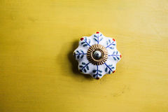 Ceramic Knob. In a Yellow Background Royalty Free Stock Photo
