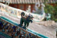 Ceramic  kylin on the ridge of house. Ceramic  kylin on the ridge,auspicous symbole,Ancestral Temple,Foshan,South China,Asia Royalty Free Stock Photography