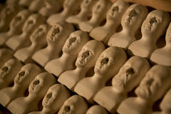 Ceramic miniature heads. Ceramic head type display from a medical antiques collection dating back to the 1800s Stock Image