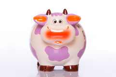 Ceramic money cow. Funny colorful ceramic cow for collecting money Royalty Free Stock Photography