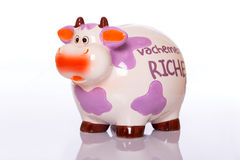 Ceramic money cow. Funny colorful ceramic cow for collecting money Stock Image