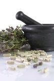 Ceramic mortar, thyme and herbal pills. Black ceramic mortar, dry thyme and herbal pills Stock Photo