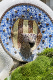 Ceramic mosaics decorated fountain - Guell Park Stock Photo