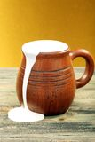 Ceramic mug with cream. Stock Image
