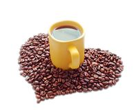 Ceramic mug and a heart of coffee beans Stock Photo