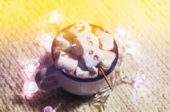 Ceramic mug with hot fresh cocoa drink and melted handmade marshmallow snowman. Ceramic mug with hot fresh cocoa drink and melted handmade funny marshmallow royalty free stock photography