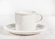 Ceramic mug with milk and saucer Stock Photo