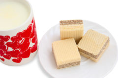 Ceramic mug with milk and a white saucer. With wafers. With clipping path Royalty Free Stock Image