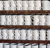 Ceramic mug. Stack of ceramic mugs in rack Stock Photography