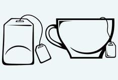 Ceramic mug with teabag label. Image isolated on blue background Royalty Free Stock Images
