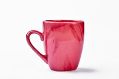 Ceramic mug on white backdrop. Stock Image